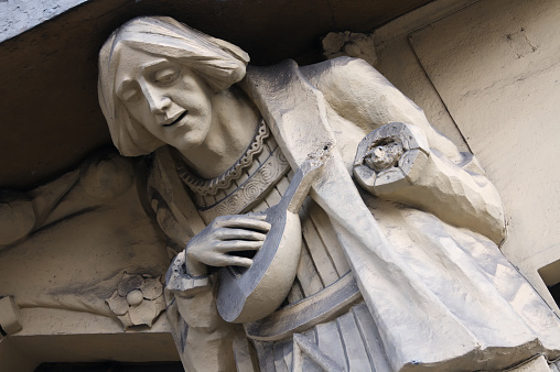 Sculpture of bard playing the lute in Prague