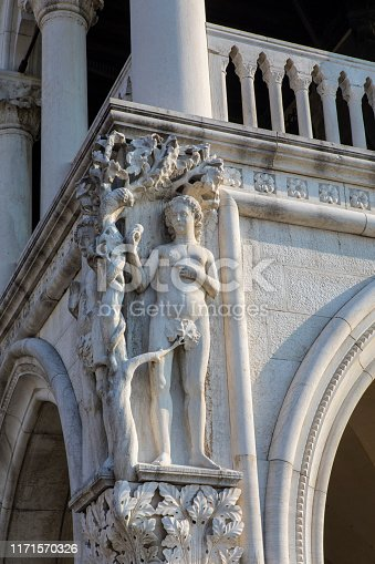 A stone carving of biblical character Eve on the exterior of Palazzo Ducale, or Doges Palace, in the historic city of Venice in Italy.
