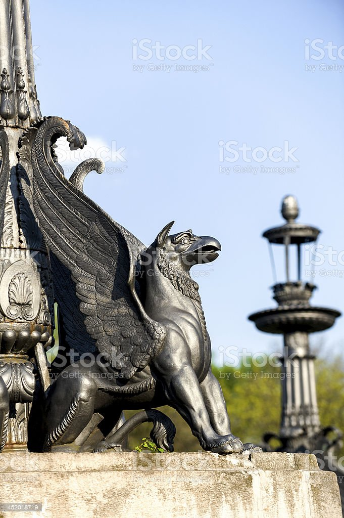 sculpture of griffin on stone pedestal stock photo