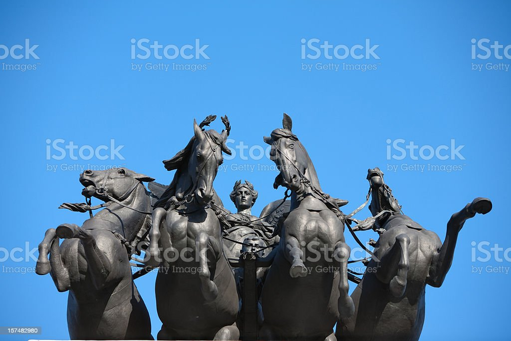 Sculpture of horses and angel stock photo