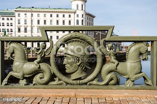 A sculpture of knight head and horse on the bridge of the moat  in the downtown of  Gothenburg, Sweden