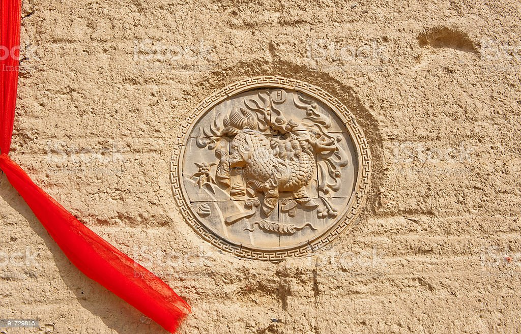 Sculpture of kylin on clay wall, China stock photo