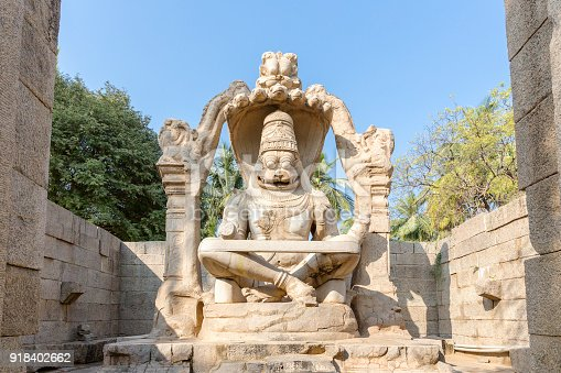 istock sculpture of Narasimha monolith carved in-situ, Hampi, Karnataka, India 918402662