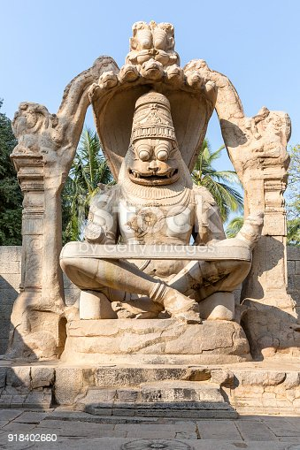 istock sculpture of Narasimha monoliths carved in-situ, Hampi, Karnataka, India 918402660