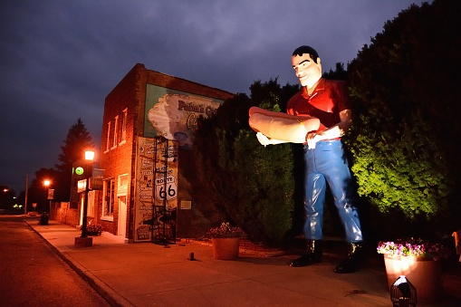 Atlanta, Illinois - July 16: Sculpture of Paul Bunyon giant man holding a hot dog in Atlanta, Illinois. It is an attraction of Route 66.