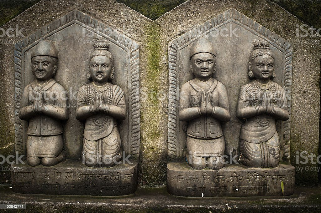 Sculpture of praying peoples. Nepal royalty-free stock photo