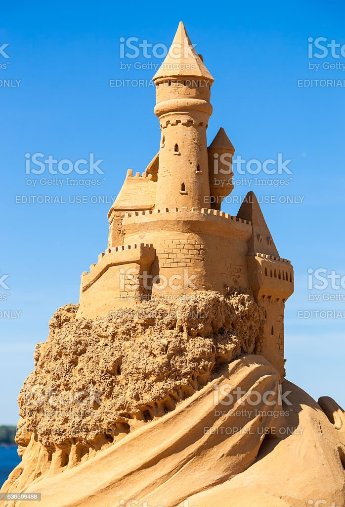 Sculpture of sand castle against blue sky stock photo