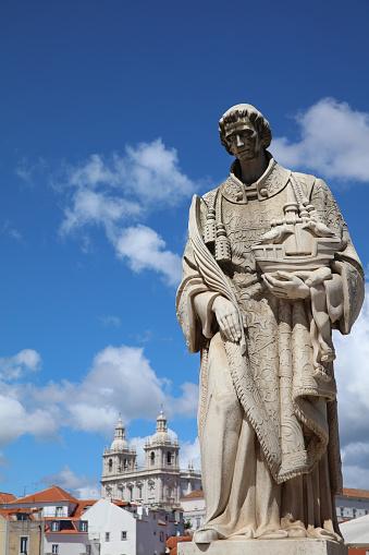 Sculpture of Sao Vicente (St. Vincent of Saragossa), Lisbon's Patron Saint, with Igreja de Sao Vicente de Fora in the Background. Lisbon. Portugal