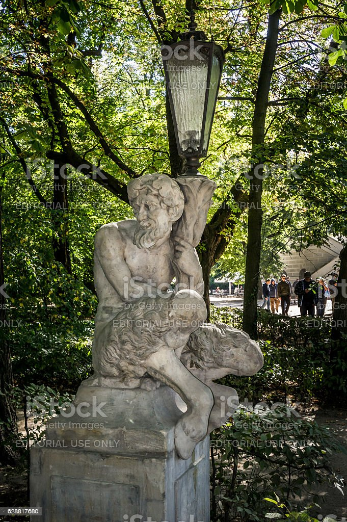 Sculpture of Satyr with lantern, Lazienki Park, Warsaw stock photo