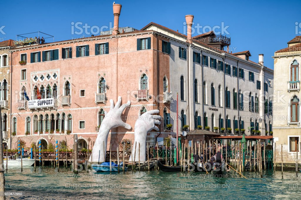 Sculpture SUPPORT and gondolas in Venice, Italy stock photo