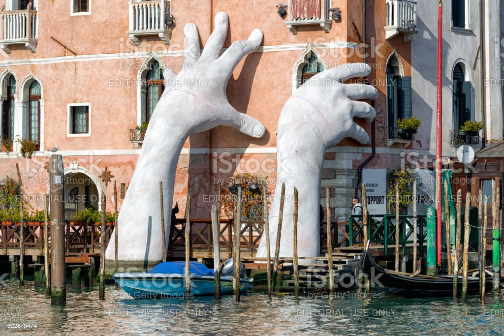 Sculpture SUPPORT in Venice, Italy stock photo