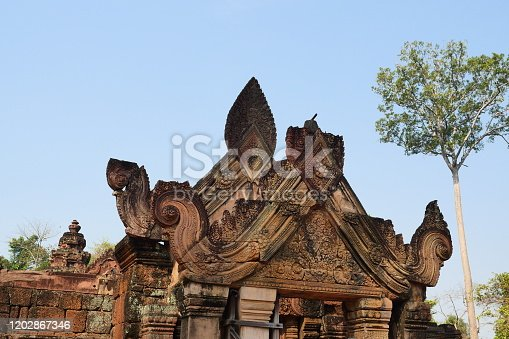Sculpture with Shiva carving in front of the temple gate, Banteay Srei temple built in red sandstone of the Angkor Wat at Siem Reap , Cambodia