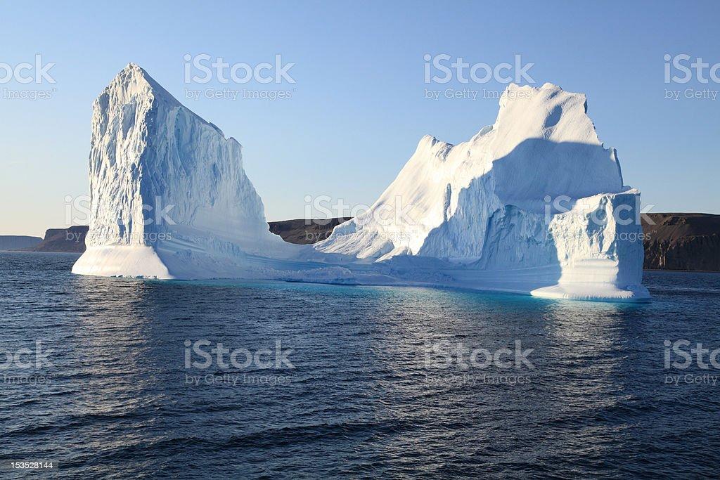 Sculptured iceberg off Cape Ricketts, Devon Island, Nunavut, Canada. stock photo