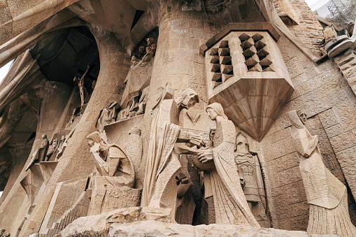 Sculptures and statues on the facade of the Sagrada Familia building.