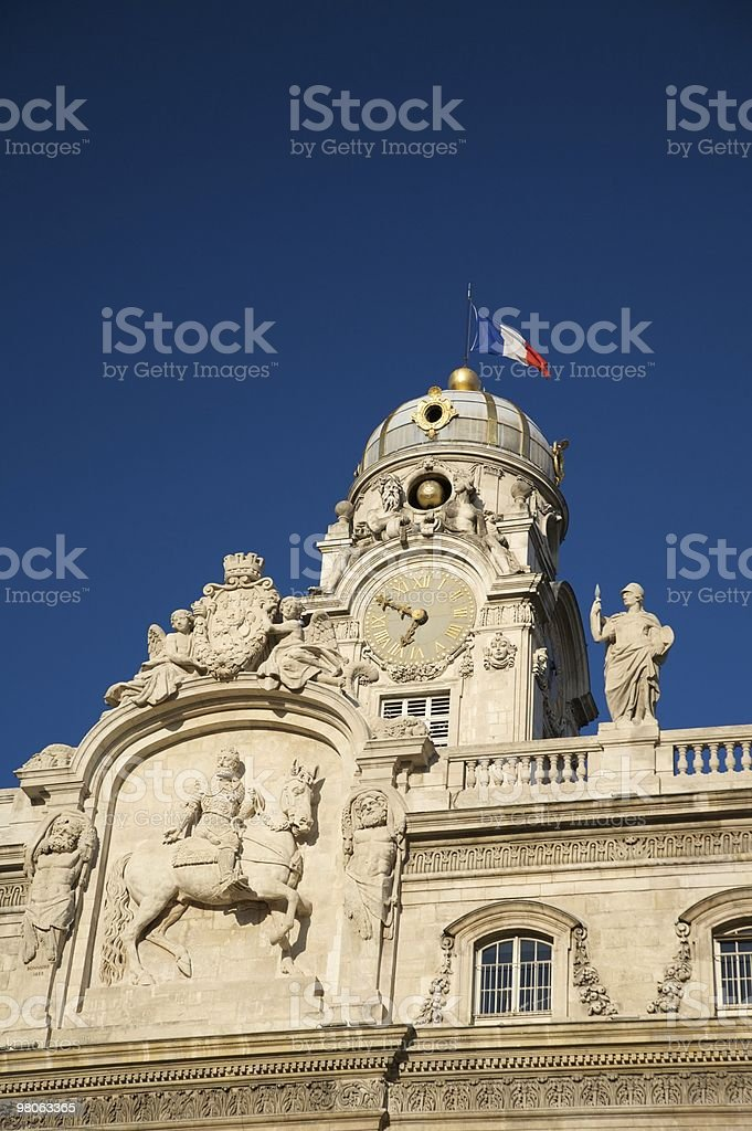 sculptures at the top of building royalty-free stock photo