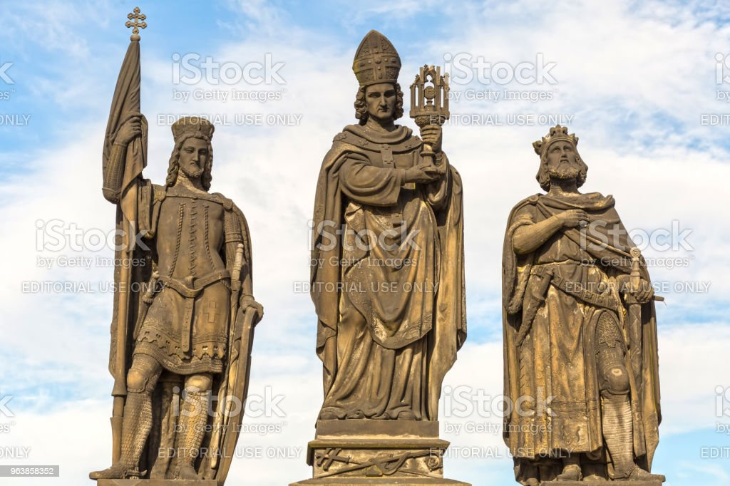 Sculptures  Charles Bridge. Statues of three figures - Saint Norbert, St. Vaclav and St. Sigismund. Prague Czech Republic February 2017 year - Royalty-free Ancient Stock Photo