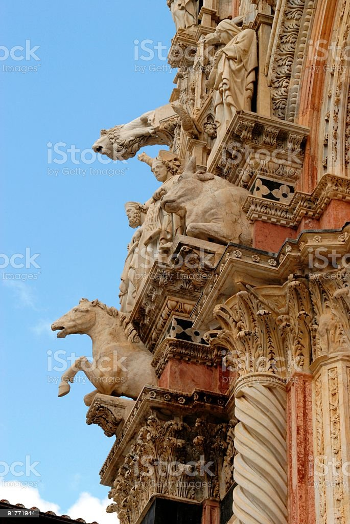 Sculptures on the Duomo of Siena, Italy stock photo