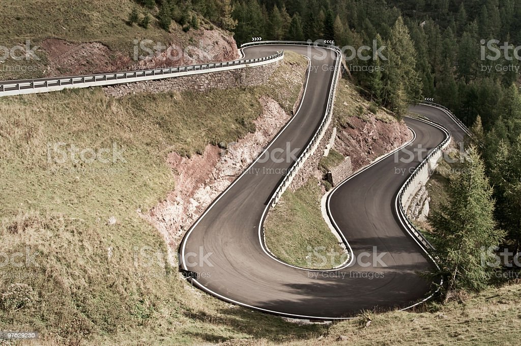 S-curve in a rally road (Italy - Alps) royalty-free stock photo