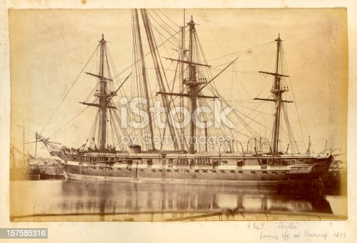 Vintage photograph of the Royal Navy warship HMS Scylla taken at Sheerness Dockyard, Kent in 1873.   Scylla was a 16 guns, 400-horse power wooden screw corvette launched in 1856 and paid off in 1873. She served in the Mediterranean and the Pacific Station.