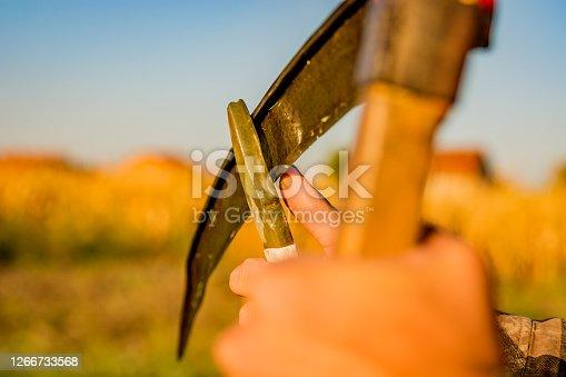 istock Scythe Sharpening, Close Up 1266733568
