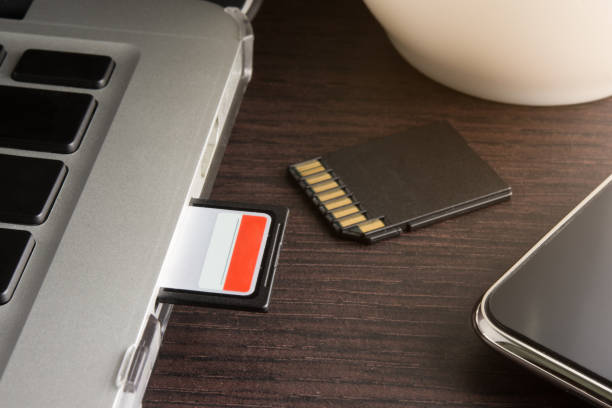 sd card inserted in laptop computer - memory card stock photos and pictures