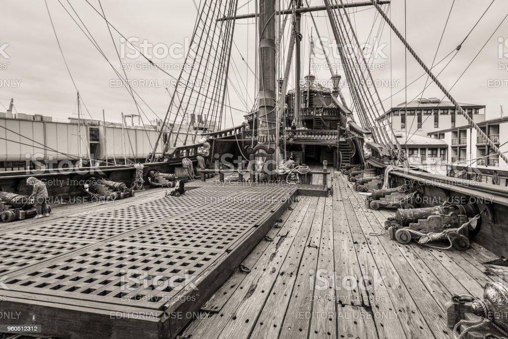 Sea adventure background, old ship and gun stock photo