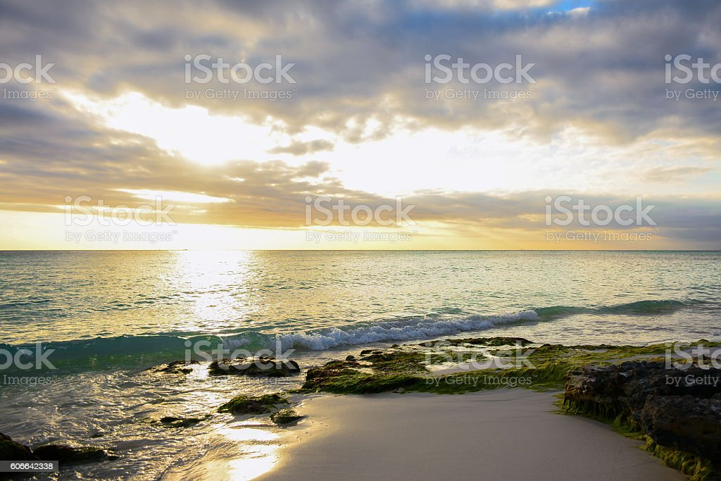 Sea and beach in the sunset with rocks - foto de stock