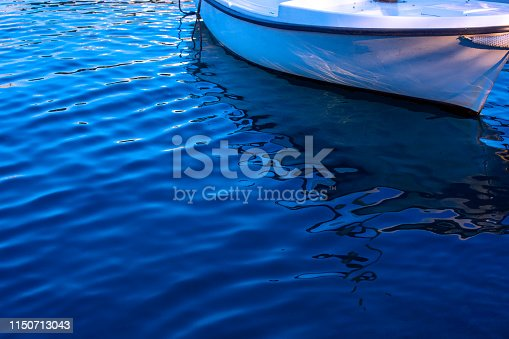 Shot of a boat in a corner and beautiful sea water texture with copy space