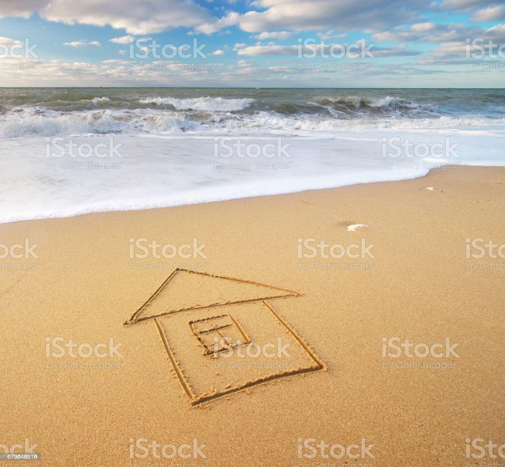 Sea and home on the sea sand stock photo