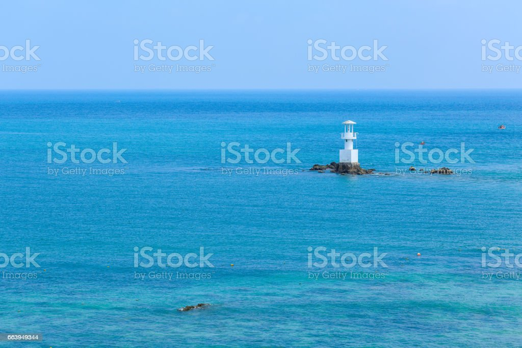 sea and lighthouse at Samaesarn in Thailand stock photo