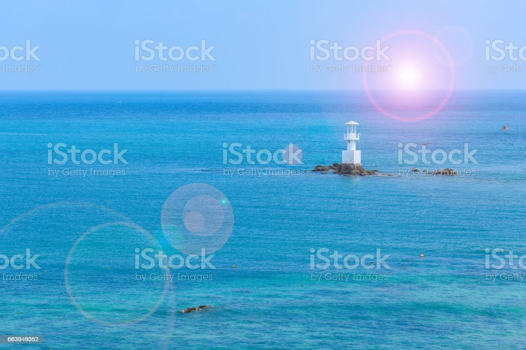 Sea and lighthouse at Smaesarn in Thailand with lens flare effect stock photo