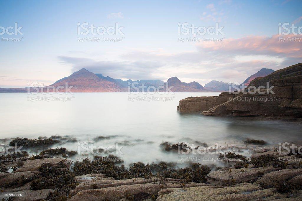 sea and shore at sunrise stock photo