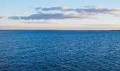 Blue sea and blue sky with clouds.
