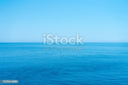 Sea and the cloudless blue sky, flowing into the horizon.