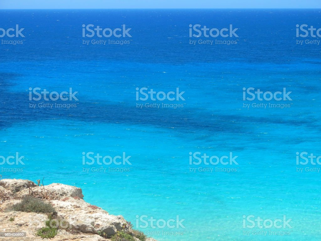 sea and the rocks in the tropical landscape in summer royalty-free stock photo