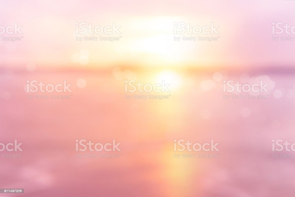 sea at sunset blurry background stock photo