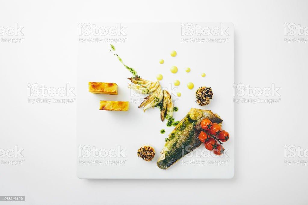 Sea bass dish on white stock photo