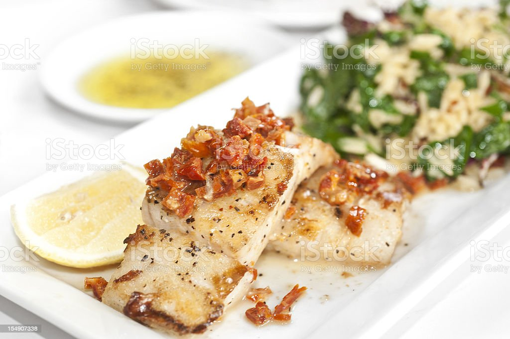 Sea Bass in sundried tomato sauce royalty-free stock photo