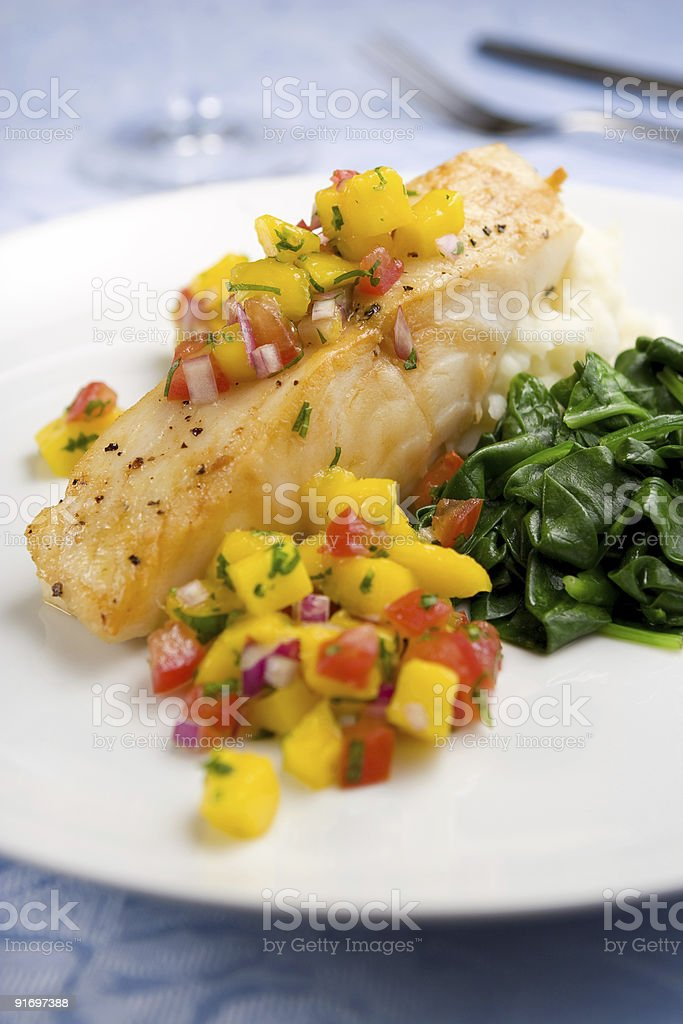 Sea bass with mango salsa stock photo