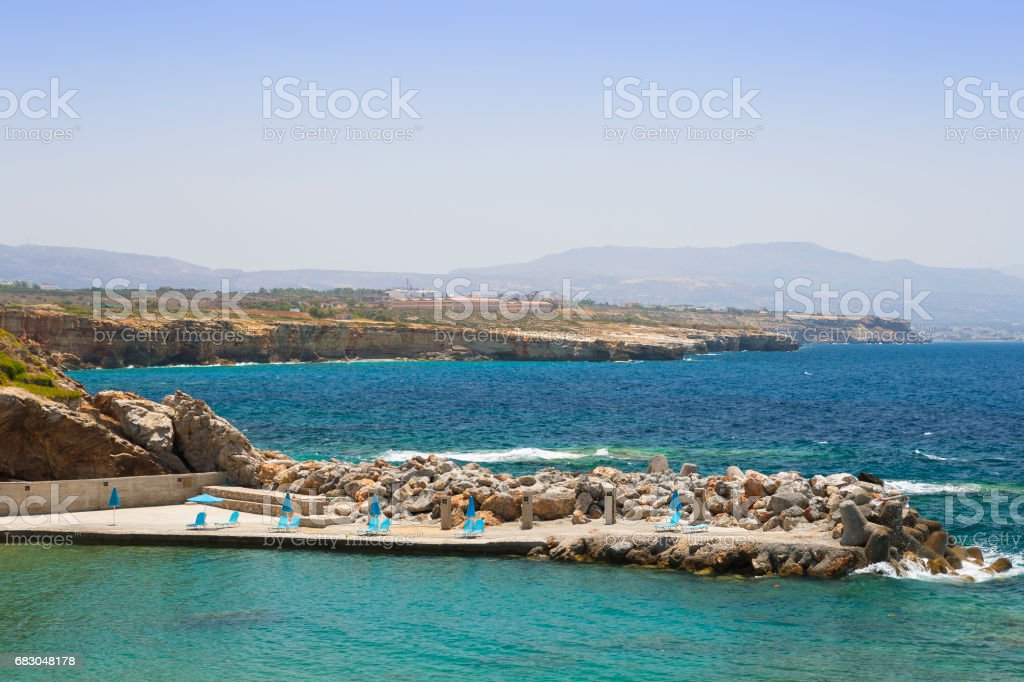 Sea bay and the beach of the village of Panormas foto de stock royalty-free