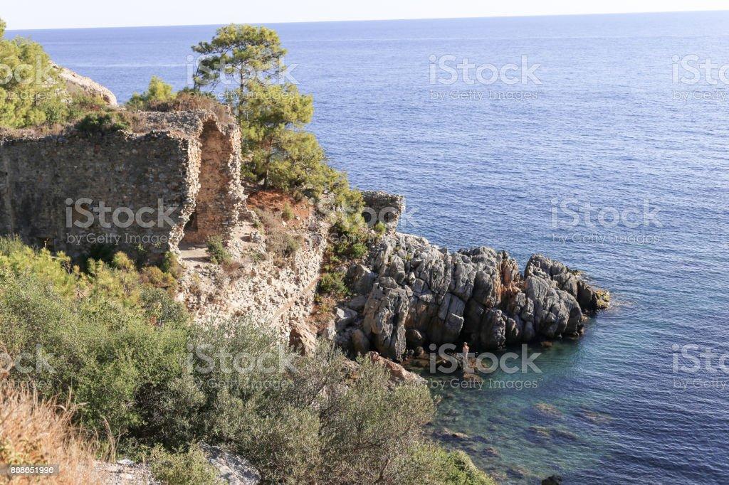 Sea bay with ancient ruins stock photo
