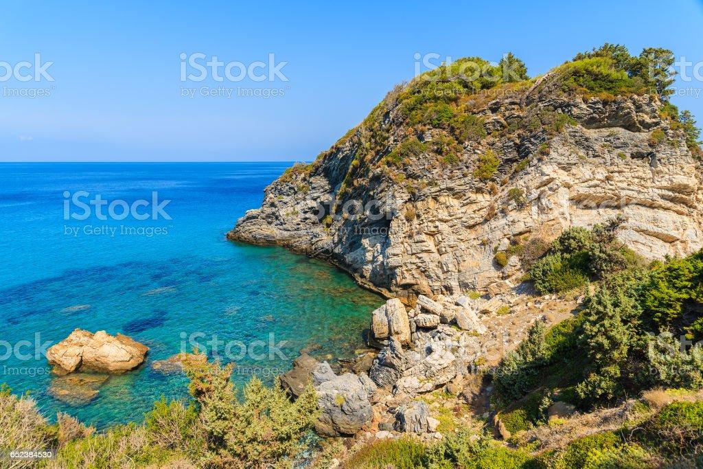 Sea bay with crystal clear water on coast of Samos island, Greece stock photo