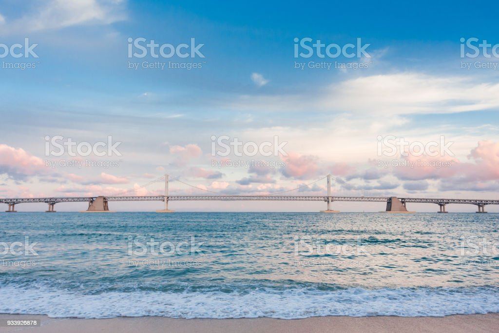 Sea, beach and bridge stock photo