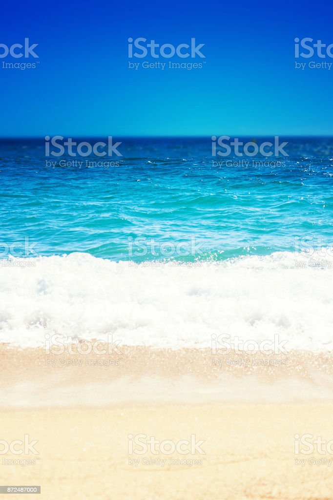 Sea Beach and Soft wave of blue ocean.  Summer day and sandy beach background'n stock photo