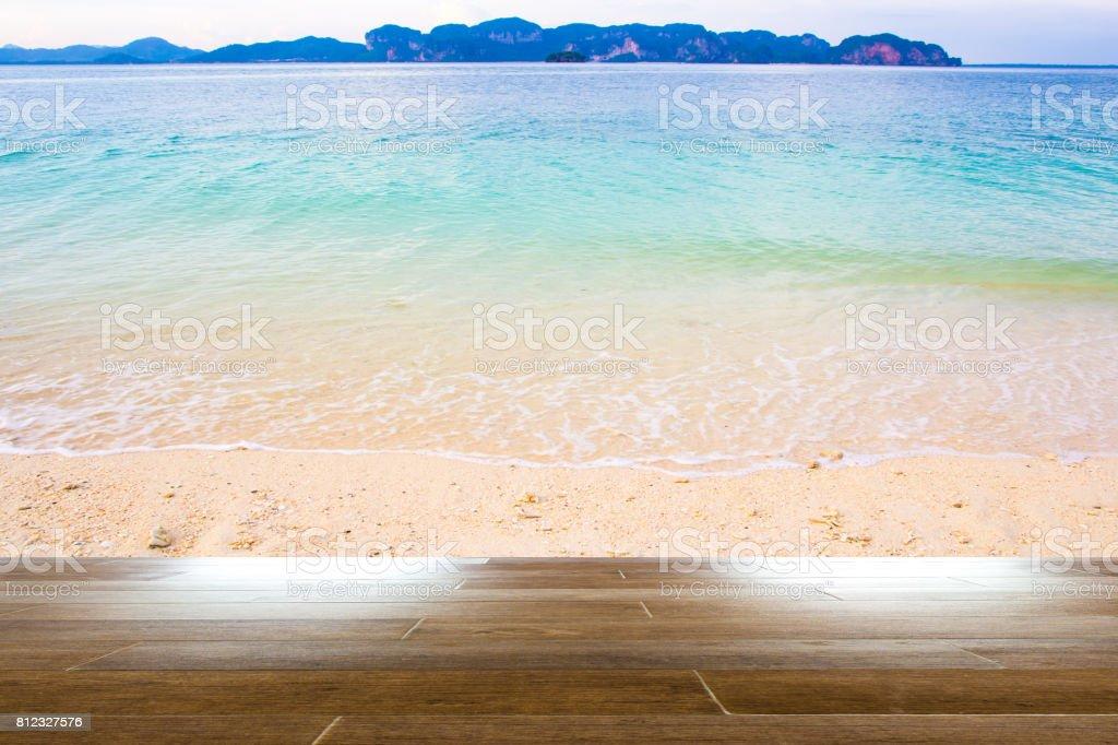 Sea beach in summer with wooden floor stock photo