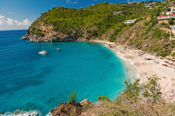 Sea beach with blue water, white sand and mountain landscape in gustavia, st.barts. Summer vacation on tropical beach. Recreation, leisure and relax concept. Wanderlust and travel with adventure. stock photo