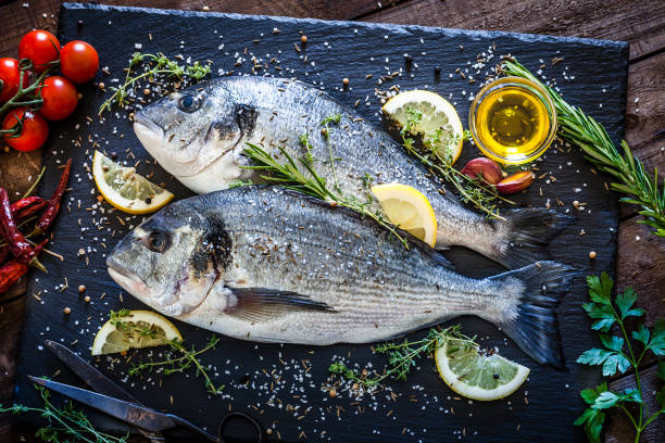 Sea bream and ingredients for cooking and seasoning picture id959282874?b=1&k=6&m=959282874&s=612x612&w=0&h=2fhcd3kisjczahpcelp5vmuo 3jood3na0 im06r xi=