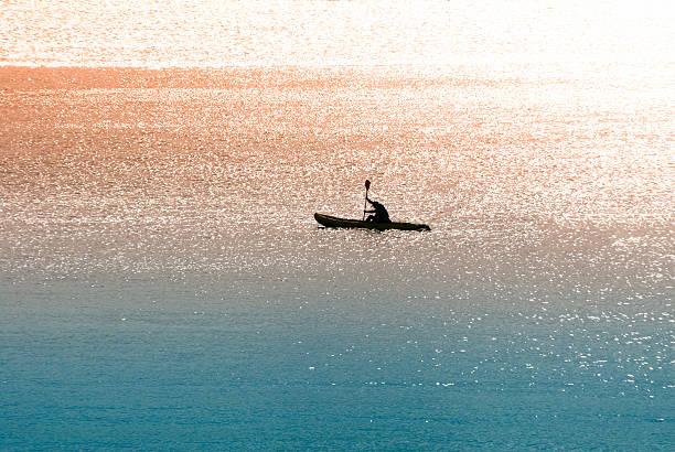 Sea canoeist (water sports) at dawn stock photo