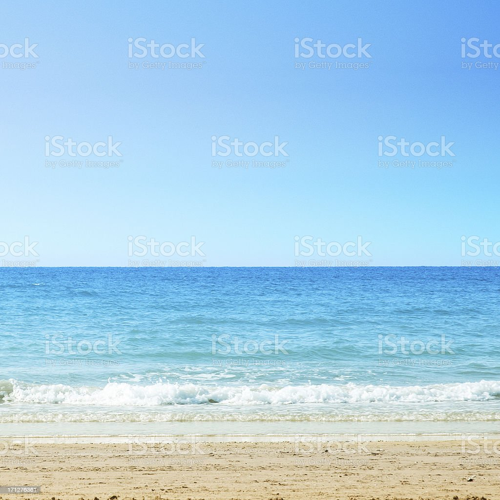 Sea, clear sky and sand stock photo