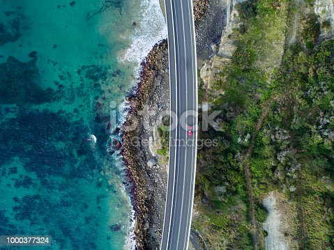 Aerial photograph of a car driving through the Sea Cliff Bridge, New South Wales
